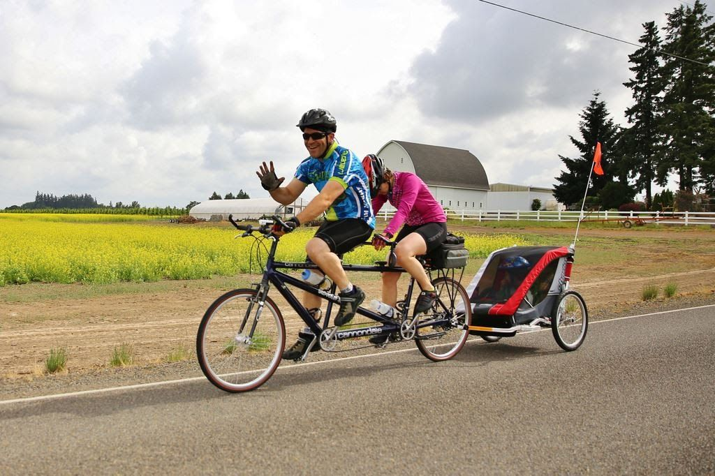 couple on tandem with trailer